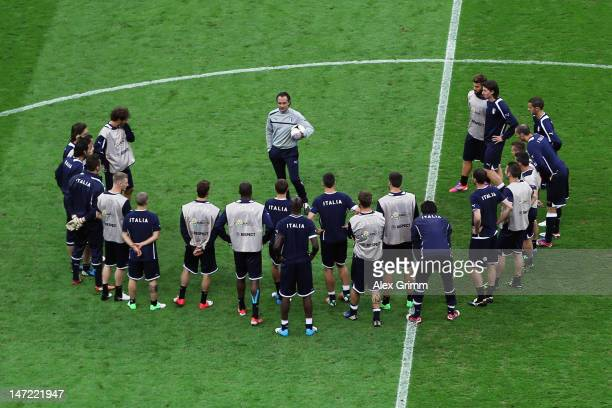 Head coach Cesare Prandelli of Italy talks to players during a training session ahead of their UEFA EURO 2012 semifinal match against Germany at...