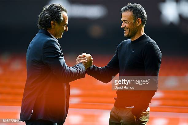 Head coach Cesare Prandelli of Valencia CF and Head coach Luis Enrique of FC Barcelona shake hands prior to the La Liga match between Valencia CF and...