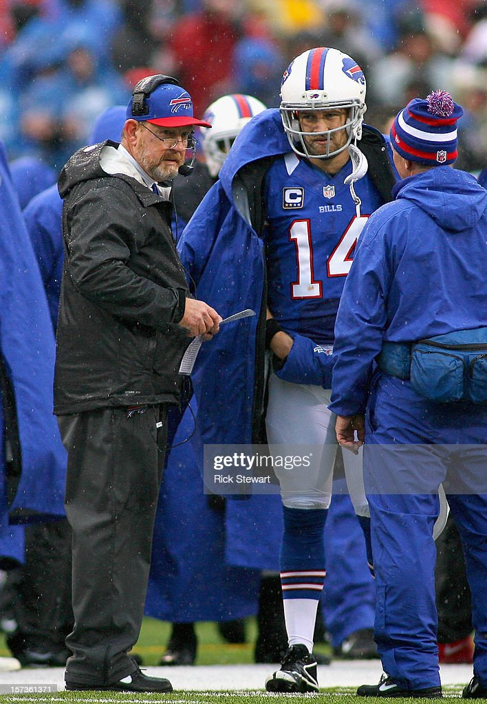 Head coach <a gi-track='captionPersonalityLinkClicked' href=/galleries/search?phrase=Chan+Gailey&family=editorial&specificpeople=2253963 ng-click='$event.stopPropagation()'>Chan Gailey</a> and <a gi-track='captionPersonalityLinkClicked' href=/galleries/search?phrase=Ryan+Fitzpatrick&family=editorial&specificpeople=622098 ng-click='$event.stopPropagation()'>Ryan Fitzpatrick</a> #14 of the Buffalo Bills talk during a timeout against the Jacksonville Jaguars at Ralph Wilson Stadium on December 2, 2012 in Orchard Park, New York. Buffalo won 34-18.