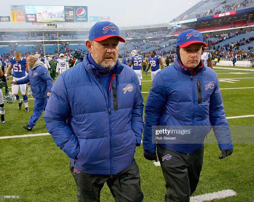 Head coach Chan Gailey (L) of the Buffalo Bills walks off the field after defeating the New York Jets at Ralph Wilson Stadium on December 30, 2012 in Orchard Park, New York.