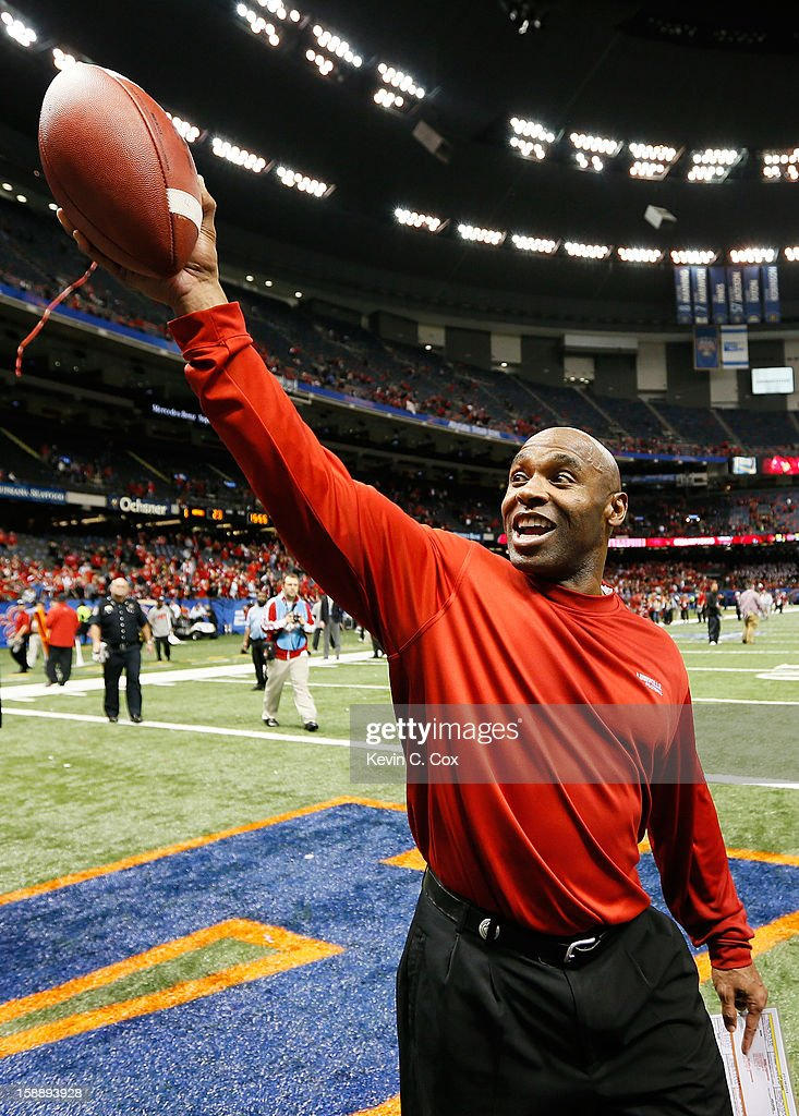 Head coach Charlie Strong of the Louisville Cardinals celebrates after they defeated the Florida Gators 33 to 23 in the Allstate Sugar Bowl at Mercedes-Benz Superdome on January 2, 2013 in New Orleans, Louisiana.