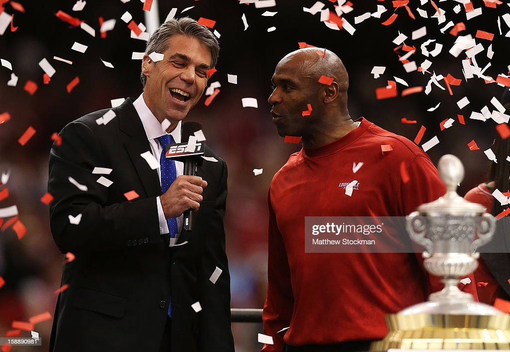 Head coach Charlie Strong of the Louisville Cardinals is interviewed by sportscaster Chris Fowler as he celebrates their 33 to 23 win over the Florida Gators in the Allstate Sugar Bowl at Mercedes-Benz Superdome on January 2, 2013 in New Orleans, Louisiana.
