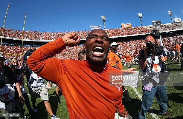Head coach Charlie Strong of the Texas Longhorns celebrates after the Longhorns beat the Oklahoma Sooners 2417 during the ATT Red River Showdown at...