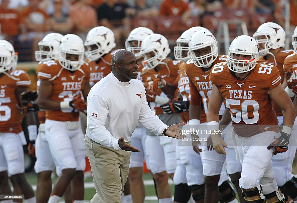 Head coach Charlie Strong of the Texas Longhorns encourages his team in warmups before playing the BYU Cougars on September 6 2014 at Darrell K...