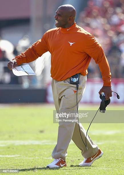 Head coach Charlie Strong of the Texas Longhorns leads the Lopnghorns against the Oklahoma Sooners in the first half during the ATT Red River...
