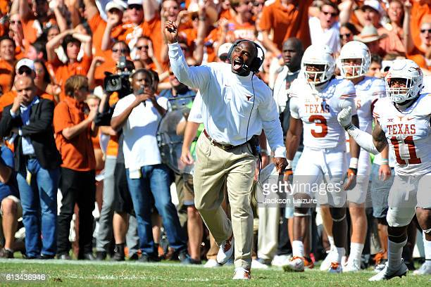 Head coach Charlie Strong of the Texas Longhorns reacts to a Sooners fumble during their loss to the Oklahoma Sooners on October 8 2016 at The Cotton...