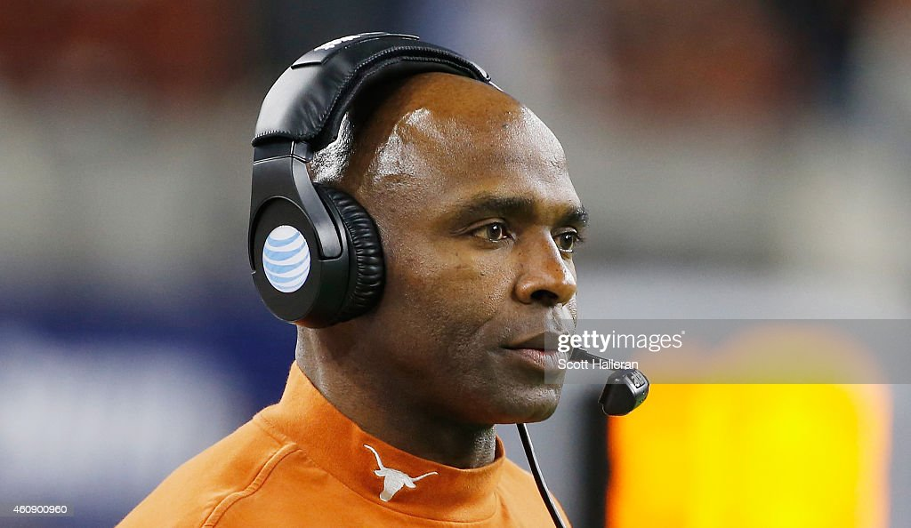 Head coach Charlie Strong of the Texas Longhorns waits near the sideline during the first half of the game against the Arkansas Razorbacks at the...
