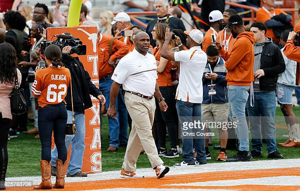Head coach Charlie Strong of the Texas Longhorns walks on the field before the game against the TCU Horned Frogs at Darrell K Royal Texas Memorial...