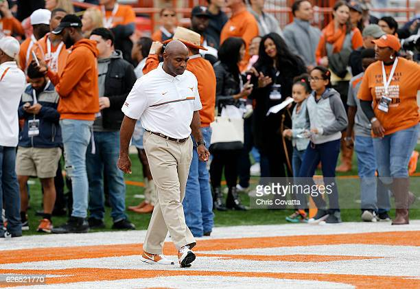 Head coach Charlie Strong of the Texas Longhorns walks on the field for the last time before the game against the TCU Horned Frogs at Darrell K Royal...