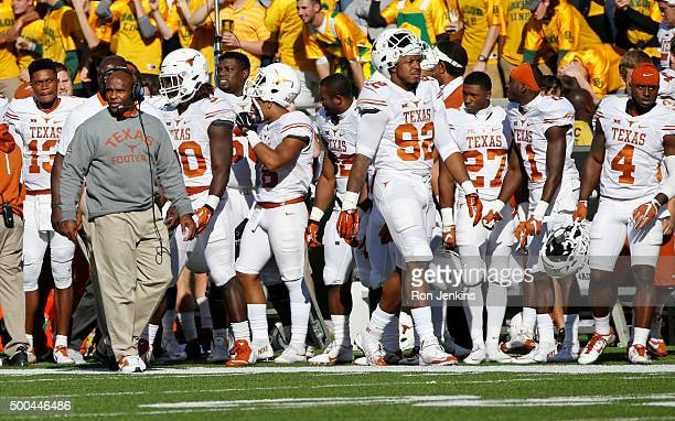 Head coach Charlie Strong of the Texas Longhorns walks the sidelines against the Baylor Bears at McLane Stadium on December 5 2015 in Waco Texas