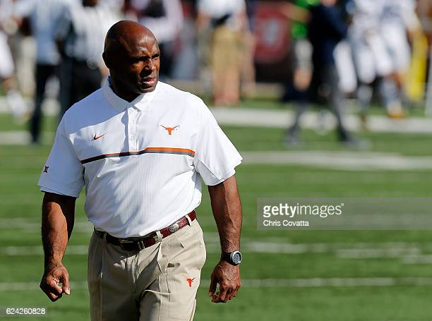 Head coach Charlie Strong of the Texas Longhorns watches as his team warmsup before the game against the West Virginia Mountaineers at Darrell K...