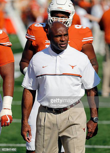 Head coach Charlie Strong of the Texas Longhorns watches his team before the game with the West Virginia Mountaineers at Darrell K Royal Texas...