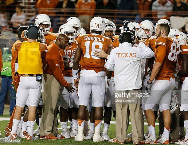 Head coach Charlie Strong talks to Tyrone Swoopes of the Texas Longhorns during timeout as they play the TCU Horned Frogs at Darrell K Royal Texas...