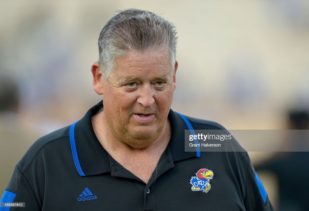Head coach <a gi-track='captionPersonalityLinkClicked' href=/galleries/search?phrase=Charlie+Weis&family=editorial&specificpeople=631229 ng-click='$event.stopPropagation()'>Charlie Weis</a> of the Kansas Jayhawks leaves the field after a loss to the Duke Blue Devils at Wallace Wade Stadium on September 13, 2014 in Durham, North Carolina. Duke won 41-3.