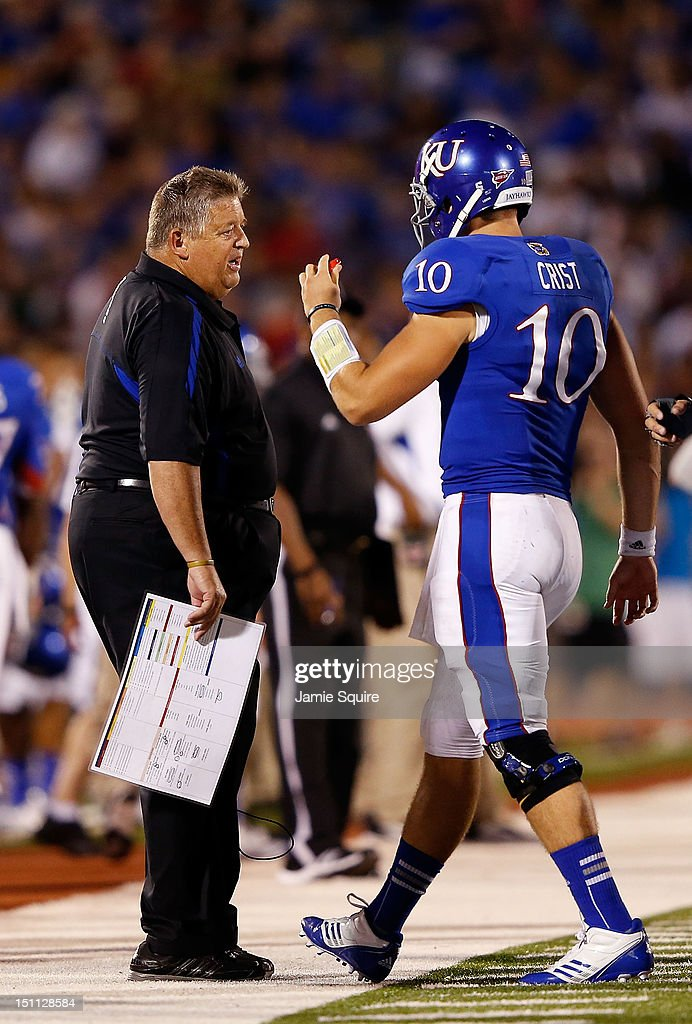 Head coach <a gi-track='captionPersonalityLinkClicked' href=/galleries/search?phrase=Charlie+Weis&family=editorial&specificpeople=631229 ng-click='$event.stopPropagation()'>Charlie Weis</a> of the Kansas Jayhawks talks with quarterback Dayne Crist #10 during the game against the South Dakota State Jackrabbits at Memorial Stadium on September 1, 2012 in Lawrence, Kansas.