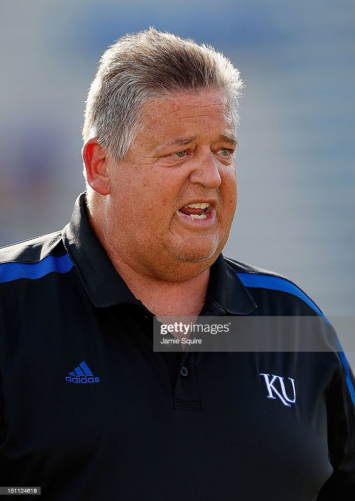 Head coach <a gi-track='captionPersonalityLinkClicked' href=/galleries/search?phrase=Charlie+Weis&family=editorial&specificpeople=631229 ng-click='$event.stopPropagation()'>Charlie Weis</a> of the Kansas Jayhawks watches during player warm-ups prior to the start of the game against the South Dakota State Jackrabbits at Memorial Stadium on September 1, 2012 in Lawrence, Kansas.