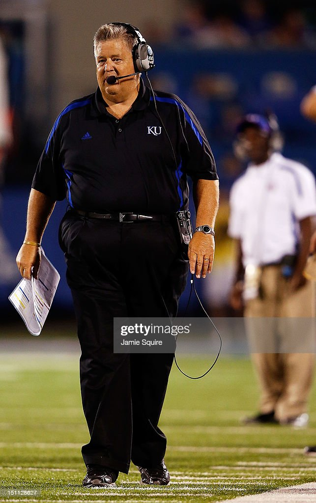 Head coach <a gi-track='captionPersonalityLinkClicked' href=/galleries/search?phrase=Charlie+Weis&family=editorial&specificpeople=631229 ng-click='$event.stopPropagation()'>Charlie Weis</a> of the Kansas Jayhawks watches from the sidelines during the game against the South Dakota State Jackrabbits at Memorial Stadium on September 1, 2012 in Lawrence, Kansas.