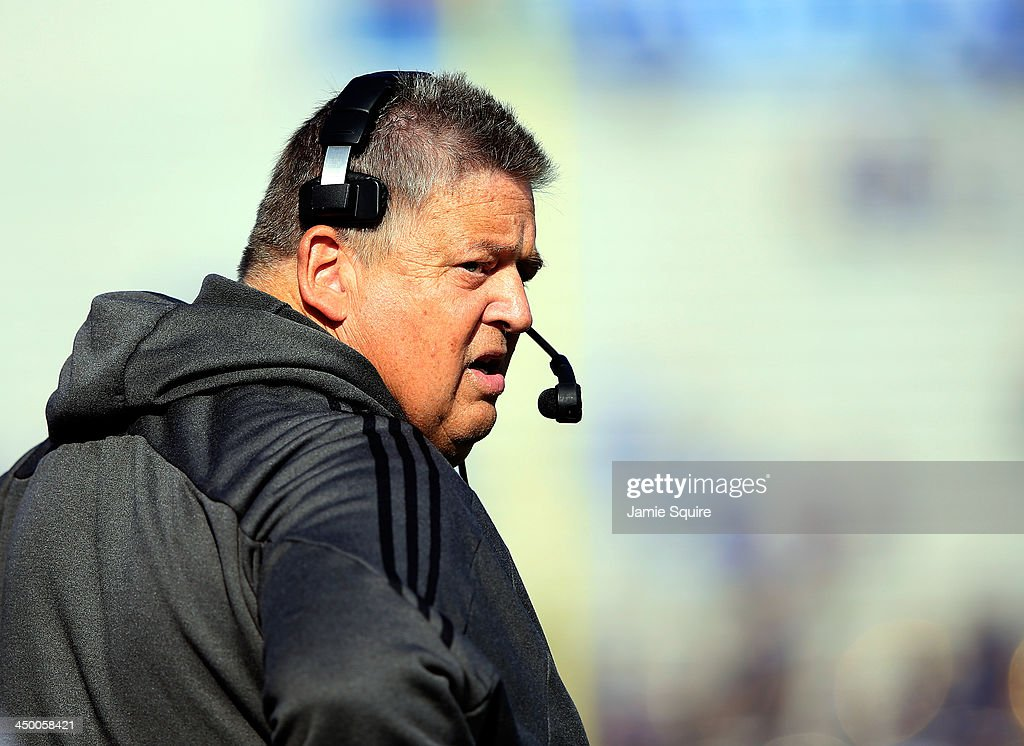Head coach <a gi-track='captionPersonalityLinkClicked' href=/galleries/search?phrase=Charlie+Weis&family=editorial&specificpeople=631229 ng-click='$event.stopPropagation()'>Charlie Weis</a> of the Kansas Jayhawks watches from the sidelines during the game against the West Virginia Mountaineers at Memorial Stadium on November 16, 2013 in Lawrence, Kansas.
