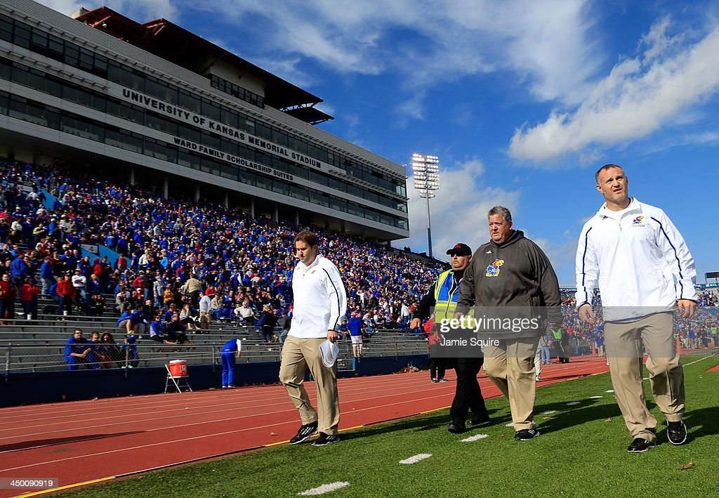 Head coach <a gi-track='captionPersonalityLinkClicked' href=/galleries/search?phrase=Charlie+Weis&family=editorial&specificpeople=631229 ng-click='$event.stopPropagation()'>Charlie Weis</a> of the Kansas Jayhawks watches walks off the field during halftime of the game against the West Virginia Mountaineers at Memorial Stadium on November 16, 2013 in Lawrence, Kansas.