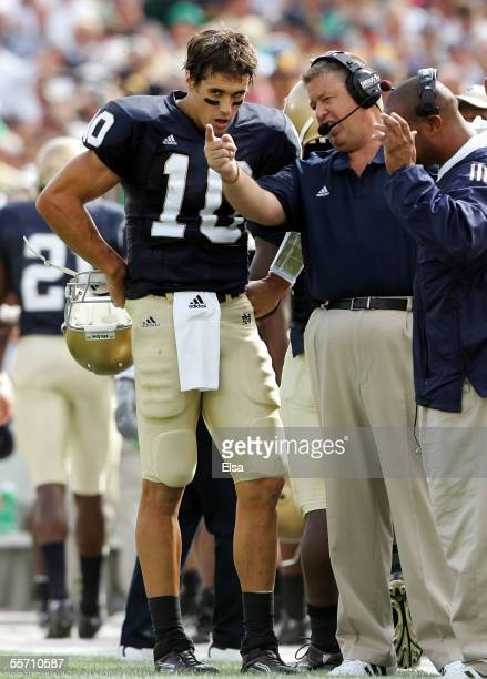 Head coach Charlie Weis of the Notre Dame Fighting Irish talks with his quarterback Brady Quinn during the first half against the Michigan State...