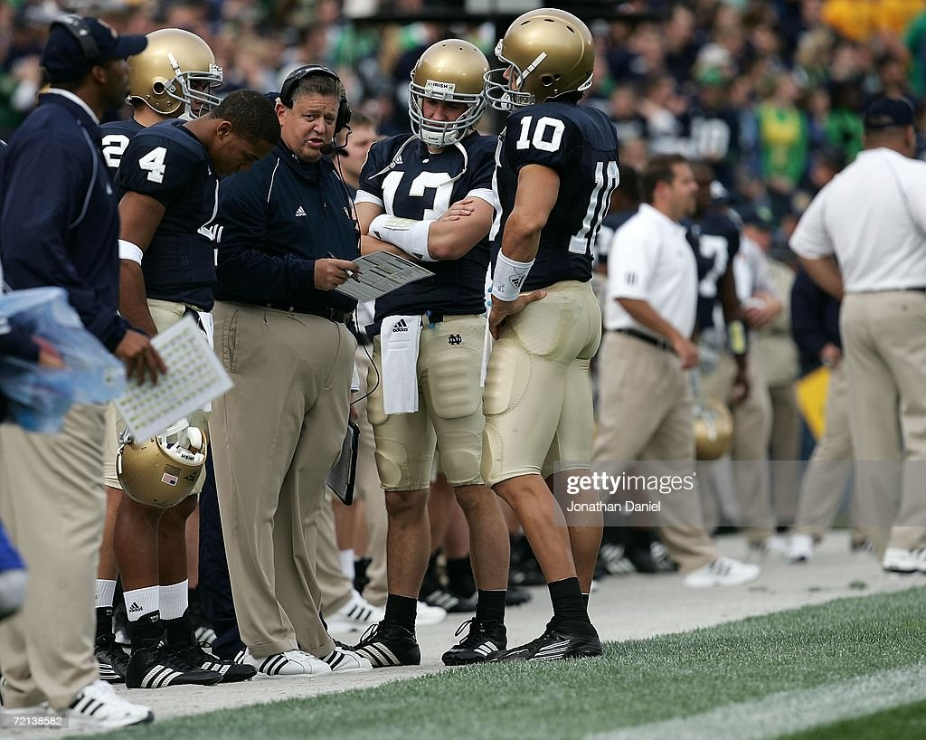Head coach Charlie Weis of the Notre Dame Fighting Irish talks with Demetrius Jones Evan Sharpley and Brady Quinn against the Purdue Boilermakers...