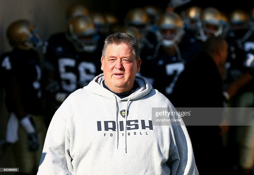 Head coach <a gi-track='captionPersonalityLinkClicked' href=/galleries/search?phrase=Charlie+Weis&family=editorial&specificpeople=631229 ng-click='$event.stopPropagation()'>Charlie Weis</a> of the Notre Dame Fighting Irish walks out of the tunnel before lining up to enter the field for a game against the Univeristy of Connecticut Huskies at Notre Dame Stadium on November 21, 2009 in South Bend, Indiana.