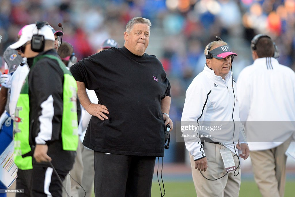 Head coach <a gi-track='captionPersonalityLinkClicked' href=/galleries/search?phrase=Charlie+Weis&family=editorial&specificpeople=631229 ng-click='$event.stopPropagation()'>Charlie Weis</a>s of the Kansas Jayhawks reacts to an instant replay call during the fourth quarter of their game against the Oklahoma Sooners on October 19, 2013 at Memorial Stadium in Lawrence, Kansas.