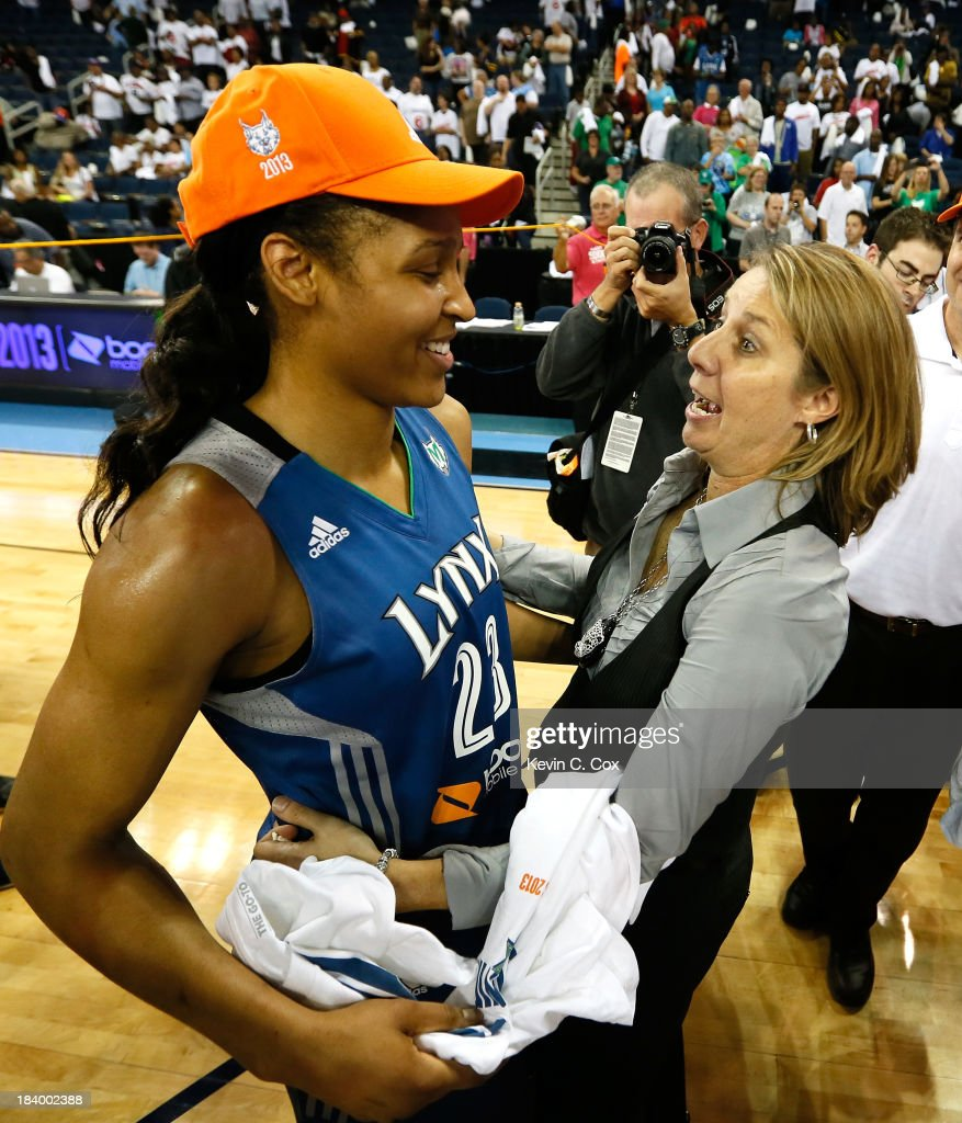 Head coach Cheryl Reeve of the Minnesota Lynx hugs Maya Moore #23 after their 86-77 win over the Atlanta Dream in Game Three of the 2013 WNBA Finals at Philips Arena on October 10, 2013 in Atlanta, Georgia.