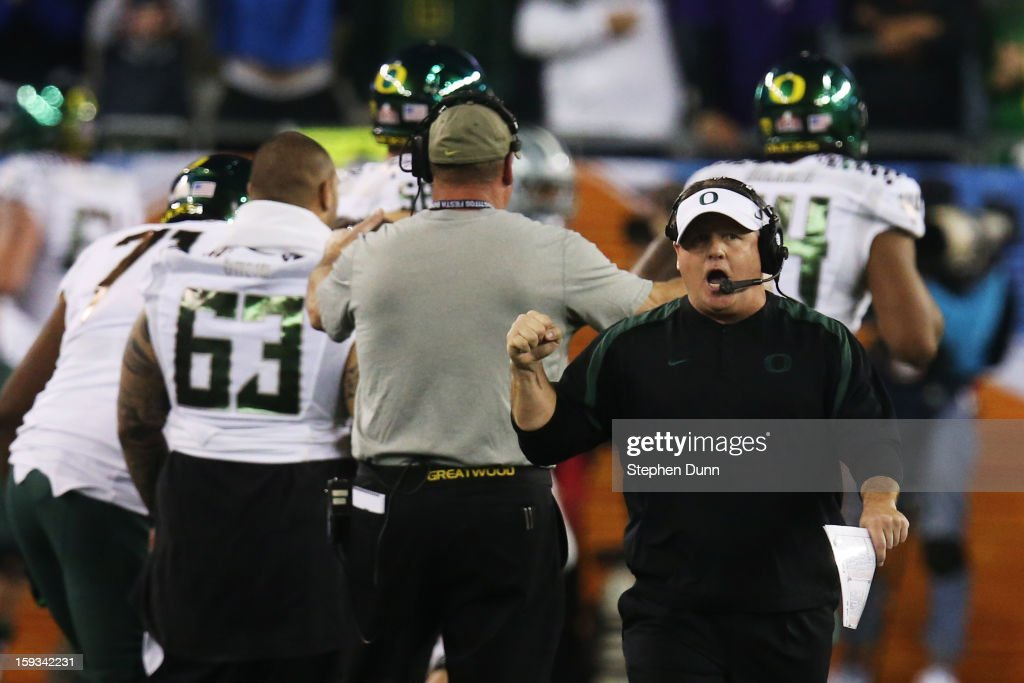 Head coach <a gi-track='captionPersonalityLinkClicked' href=/galleries/search?phrase=Chip+Kelly&family=editorial&specificpeople=6161242 ng-click='$event.stopPropagation()'>Chip Kelly</a> of the Oregon Ducks celebrates a third quarter touchdown against the Kansas State Wildcats during the Tostitos Fiesta Bowl at University of Phoenix Stadium on January 3, 2013 in Glendale, Arizona.