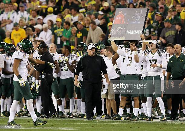 Head coach Chip Kelly of the Oregon Ducks looks on from the sideline against the Kansas State Wildcats during the Tostitos Fiesta Bowl at University...