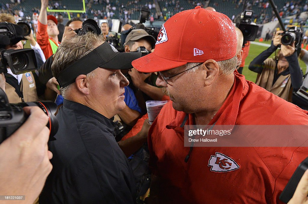 Head coach Chip Kelly of the Philadelphia Eagles and head coach Andy Reid of the Kansas City Chiefs shake hands after the game at Lincoln Financial Field on September 19, 2013 in Philadelphia, Pennsylvania. The Chiefs won 26-16.