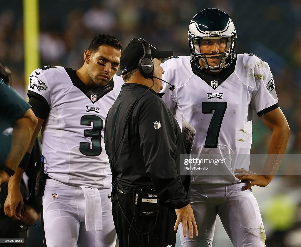 Head coach Chip Kelly of the Philadelphia Eagles talks with quarterbacks Mark Sanchez #3 and Sam Bradford #7 during a timeout against the Dallas Cowboys during the fourth quarter of a football game at Lincoln Financial Field on September 20, 2015 in Philadelphia, Pennsylvania. The Cowboys defatted the Eagles 20-10.