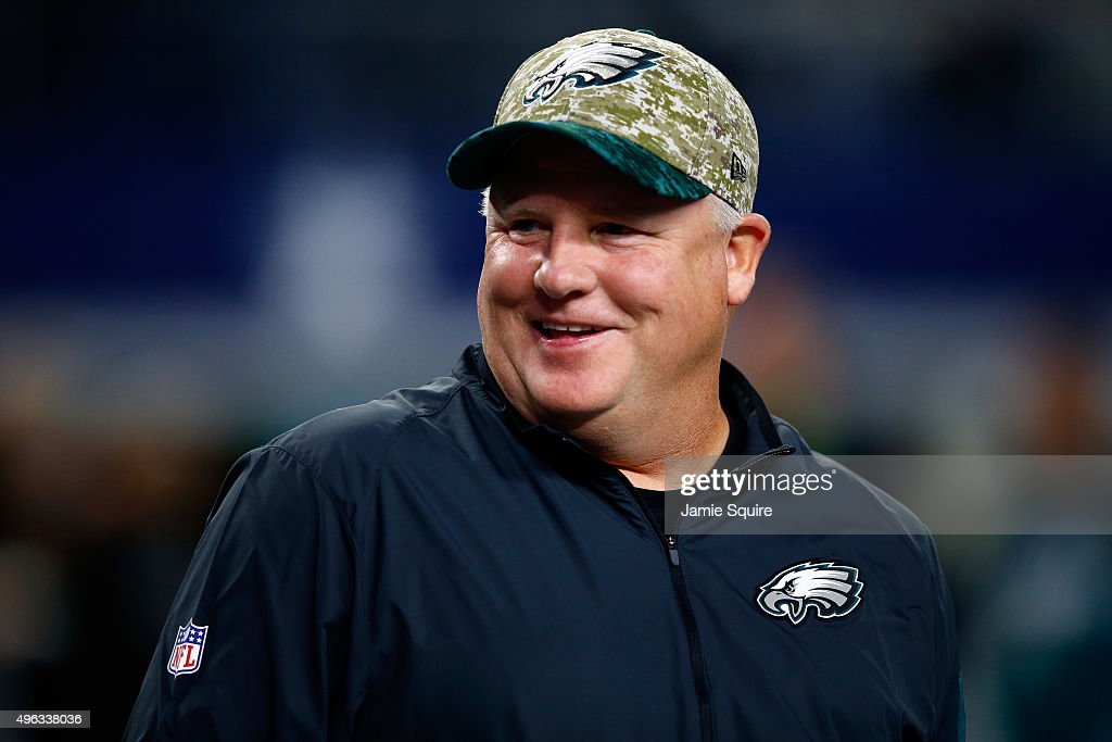 Head coach Chip Kelly of the Philadelphia Eagles talks with players during warm-ups prior to the game against the Dallas Cowboys on November 8, 2015 in Arlington, Texas.