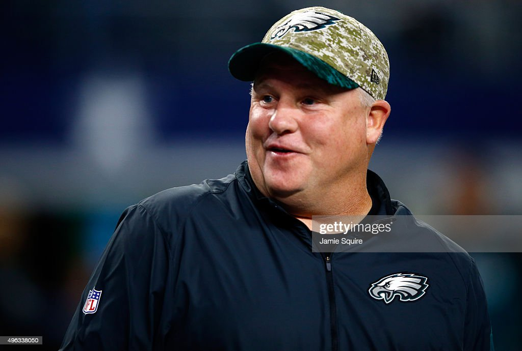 Head coach <a gi-track='captionPersonalityLinkClicked' href=/galleries/search?phrase=Chip+Kelly&family=editorial&specificpeople=6161242 ng-click='$event.stopPropagation()'>Chip Kelly</a> of the Philadelphia Eagles talks with players during warm-ups prior to the game against the Dallas Cowboys on November 8, 2015 in Arlington, Texas.