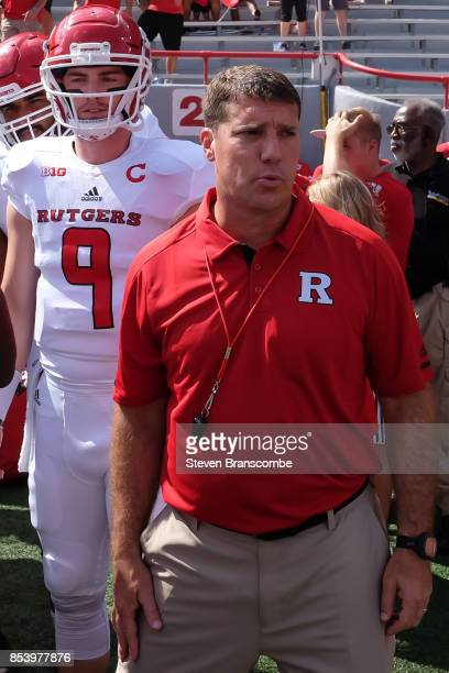 Head coach Chris Ash of the Rutgers Scarlet Knights and quarterback Kyle Bolin wait to take the field against the Nebraska Cornhuskers at Memorial...