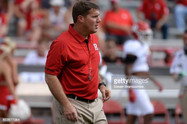 Head coach Chris Ash of the Rutgers Scarlet Knights watches warmups before the game against the Nebraska Cornhuskers at Memorial Stadium on September...