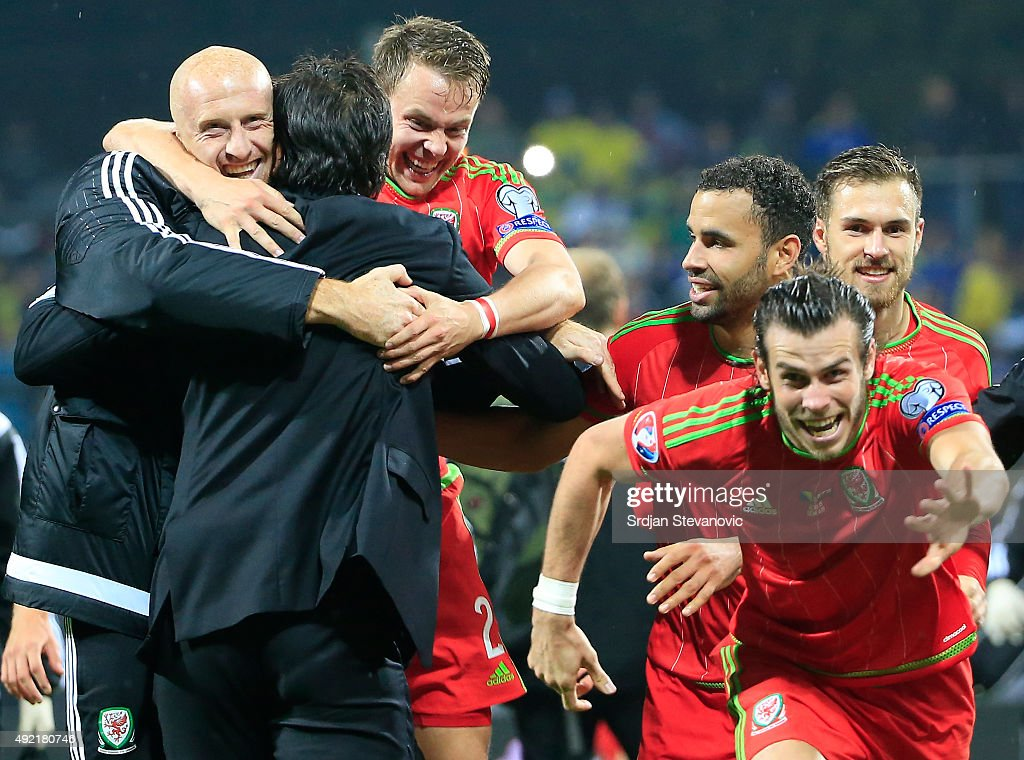 Head coach Chris Coleman of Wales celebrate with the Chris Gunter and Gareth Bale after the Euro 2016 qualifying football match between Bosnia and...