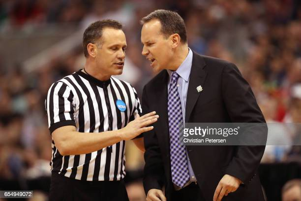 Head coach Chris Collins of the Northwestern Wildcats argues with the official against the Gonzaga Bulldogs during the second round of the 2017 NCAA...