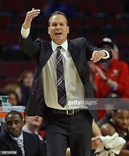 Head coach Chris Collins of the Northwestern Wildcats gives instructions to his team against the Dayton Flyers during the 2016 State Farm Chicago...