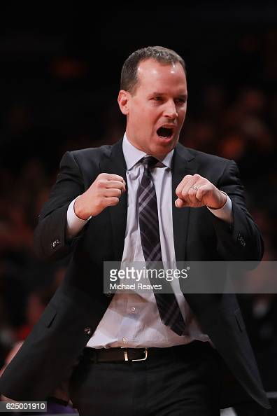 Head coach Chris Collins of the Northwestern Wildcats reacts against the Texas Longhorns in the first half of the 2016 Legends Classic at Barclays...