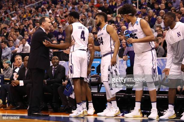 Head coach Chris Collins of the Northwestern Wildcats speaks to his team in the first half against the Vanderbilt Commodores during the first round...