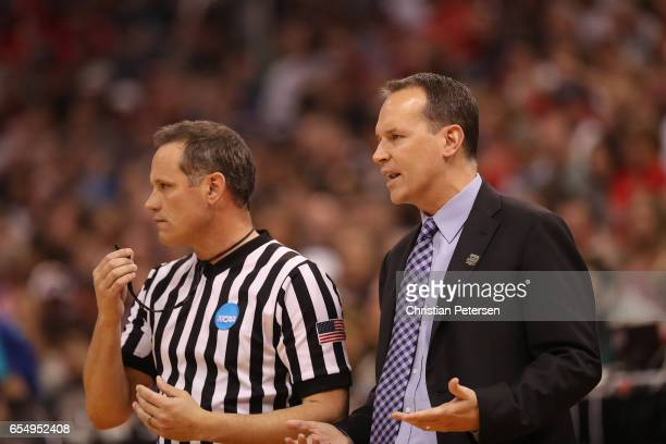 Head coach Chris Collins of the Northwestern Wildcats speaks with the official against the Gonzaga Bulldogs during the second round of the 2017 NCAA...