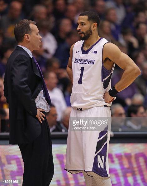 Head coach Chris Collins of the Northwestern Wildcats talks to Drew Crawford during a game against the Minnesota Golden Gophers at WelshRyan Arena on...