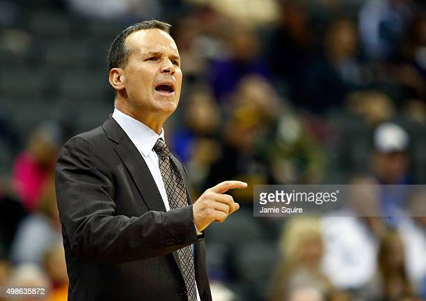 Head coach Chris Collins of the Northwestern Wildcats yells from the bench during the CBE Hall Of Fame Classic game against the Missouri Tigers at...