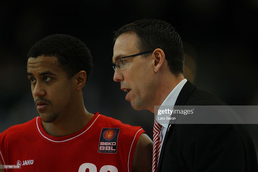 Head coach Chris Fleming of Brose speaks with his player Brian Roberts during the Beko Basketball Bundesliga match between Gloria Giants Duesseldorf...