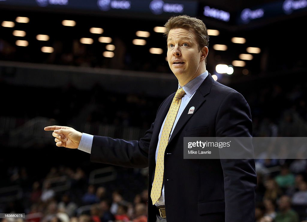 Head coach Chris Mooney of the Richmond Spiders gestures from the bench during the second half against the Charlotte 49ers during the first round of the Atlantic 10 basketball tournament at Barclays Center on March 14, 2013 in New York City.