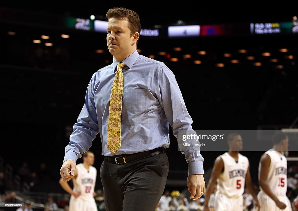 Head coach Chris Mooney of the Richmond Spiders walks off the court after being given a technical foul late in the second half against the Charlotte 49ers during the first round of the Atlantic 10 basketball tournament at Barclays Center on March 14, 2013 in New York City.