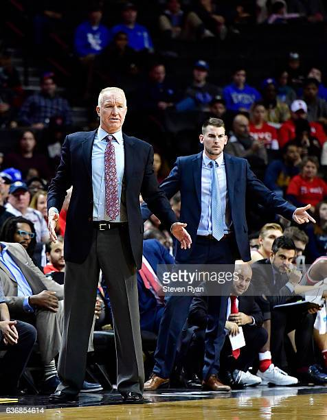 Head coach Chris Mullin and assistant coach Greg St Jean of the St JohnÕs Red Storm reacts against the Long Island Blackbirds at Barclays Center on...