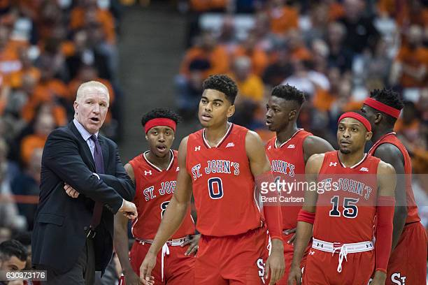 Head coach Chris Mullin of the St John's Red Storm speaks to his players during a first half time out against the Syracuse Orange on December 21 2016...