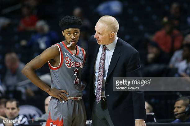 Head coach Chris Mullin of the St John's Red Storm talks with Shamorie Ponds against the Long Island Blackbirds in the second half of the Brooklyn...